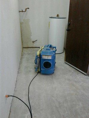 Water Heater Leak Restoration in Argyle TX by Power Flood Removal Structure Dry